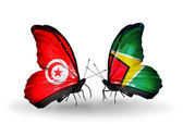Butterflies with Tunisia and Guyana flags on wings — Stock Photo