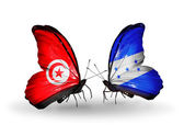 Butterflies with Tunisia and Honduras flags on wings — Zdjęcie stockowe
