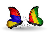 Butterflies with Armenia and  Guinea flags on wings — Stock fotografie