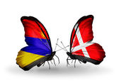 Butterflies with Armenia and  Denmark flags on wings — Stock Photo