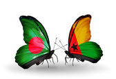 Butterflies with Bangladesh and Guinea Bissau flags on wings — Stock Photo