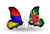 Butterflies with Armenia and  Dominica flags on wings — Stock fotografie