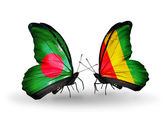Butterflies with Bangladesh and Guinea flags on wings — Stock Photo