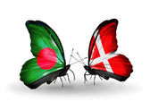 Butterflies with Bangladesh and Denmark flags on wings — Stock Photo