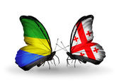 Butterflies with Gabon and Georgia flags on wings — Stock Photo