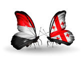 Butterflies with Yemen and  Georgia flags on wings — Stock Photo