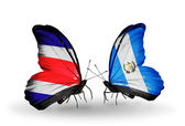 Butterflies with Costa Rica and Guatemala flags on wings — Stock Photo