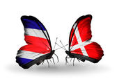 Butterflies with Costa Rica and Denmark flags on wings — Stock Photo