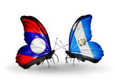 Butterflies with Laos and Guatemala flags on wings — Stock Photo