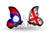 Motyle z flagi laosu i gruzji na skrzydłach — Zdjęcie stockowe