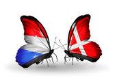 Kelebek kanatları üzerinde lüksemburg ve danimarka bayrağı ile — Stok fotoğraf