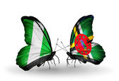 Butterflies with Nigeria and  Dominica flags on wings — Stock Photo