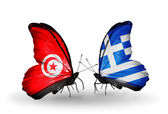 Butterflies with Tunisia and Greece flags on wings — Stock Photo