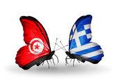 Mariposas con banderas de túnez y grecia en las alas — Foto de Stock