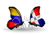 Butterflies with Venezuela and  Dominicana flags on wings — Zdjęcie stockowe