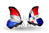 Butterflies with Luxembourg and Dominicana flags on wings — Stock Photo