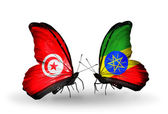 Butterflies with Tunisia and Ethiopia flags on wings — Stock Photo