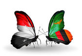 Butterflies with Yemen and  Zambia flags on wings — Stock Photo