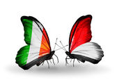 Butterflies with Ireland and Monaco, Indonesia flags on wings — Photo