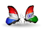 Butterflies with Luxembourg and India flags on wings — Stock Photo