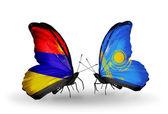 Farfalle con bandiere armenia e kazakistan sulle ali — Foto Stock