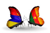 Butterflies with Armenia and  Cameroon flags on wings — Stock Photo