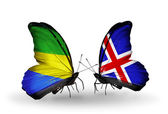 Butterflies with Gabon and Iceland flags on wings — Stock Photo