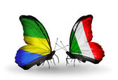 Butterflies with Gabon and Italy flags on wings — Stock Photo