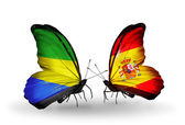 Butterflies with Gabon and Spain flags on wings — Stock Photo