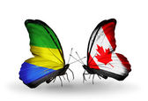 Butterflies with Gabon and Canada flags on wings — Photo