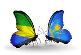 Butterflies with Gabon and Kazakhstan flags on wings — Stock Photo