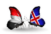 Butterflies with Yemen and   Iceland flags on wings — Stock Photo