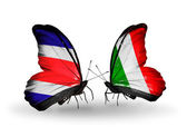 Butterflies with Costa Rica and  Italy flags on wings — Stock Photo