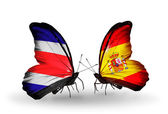 Butterflies with Costa Rica and  Spain flags on wings — Stock Photo