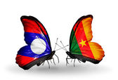 Butterflies with  Laos and  Cameroon flags on wings — Stock Photo