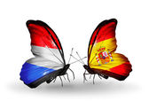 Butterflies with  Luxembourg and Spain flags on wings — Photo