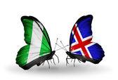 Fjärilar med nigeria och Island flaggor på vingar — Stockfoto