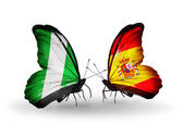Butterflies with Nigeria and  Spain flags on wings — Stock Photo