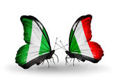 Butterflies with Nigeria and  Italy flags on wings — Stock Photo