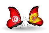 Butterflies with Tunisia and Spain flags on wings — Stock Photo