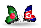 Butterflies with Bangladesh and  North Korea flags on wings — Stock Photo
