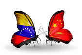 Butterflies with Venezuela and China flags on wings — Stock Photo