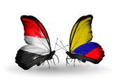 翼にイエメンとコロンビアのフラグと蝶 — ストック写真