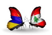Motyle z armenii i liban flagi na skrzydłach — Zdjęcie stockowe