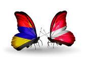 Farfalle con bandiere armenia e lettonia sulle ali — Foto Stock