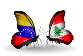 Butterflies with Venezuela and  Lebanon flags on wings — Stock Photo