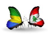 Vlinders met gabon en libanon vlaggen op vleugels — Stockfoto