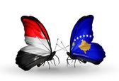 Butterflies with Yemen and  Kosovo flags on wings — Stockfoto