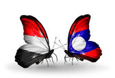 Butterflies with  Yemen and  Laos flags on wings — Stock Photo