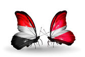 Butterflies with Yemen and  Latvia flags on wings — Stock Photo